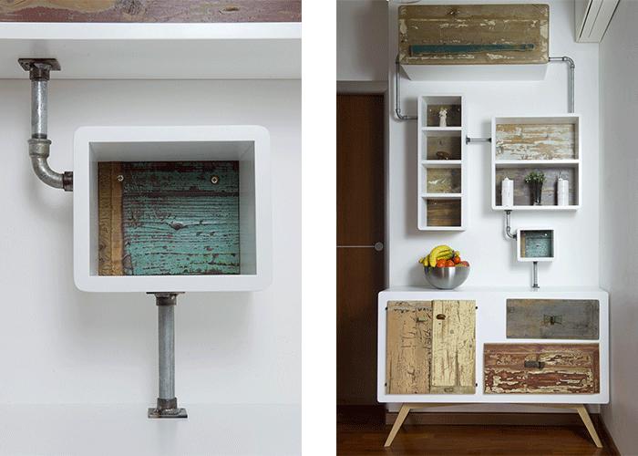 Parete attrezzata per soggiorno moderno con struttura in tubi di metallo e sportelli in legno riciclato vintage